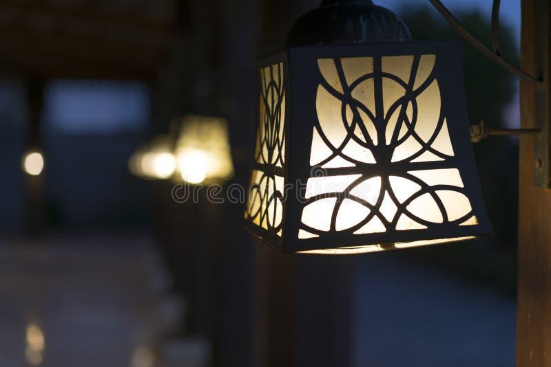 Street lamps on wooden poles. Beautiful street lighting.  stock photography