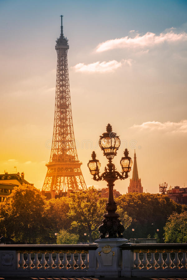 Street lantern on the Alexandre III Bridge against the Eiffel Tower in Paris. France stock photography