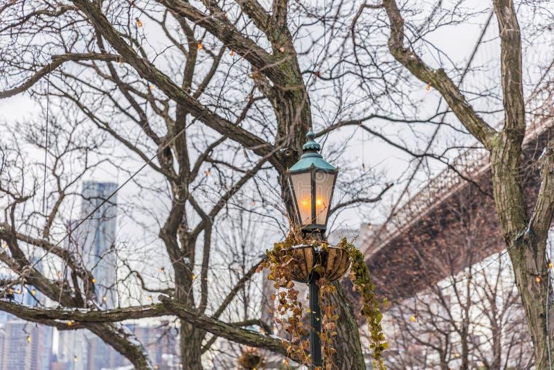 Street lantern on the background of Manhattan in winter. Street lantern on the background of Manhattan stock photos