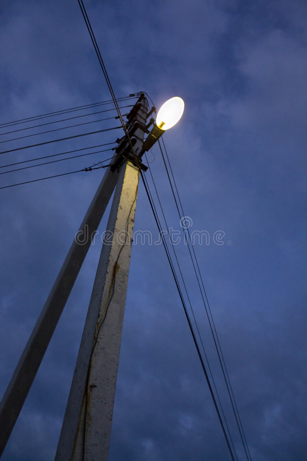Street lantern on a column at night royalty free stock photography