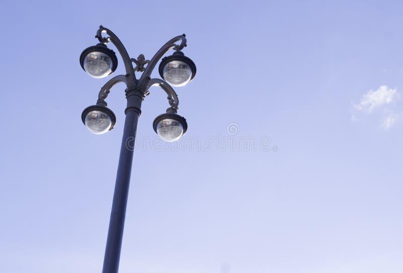 Street lantern on the sky background. city life, object. Modern street lantern on the sky background. city life, lighting stock photos