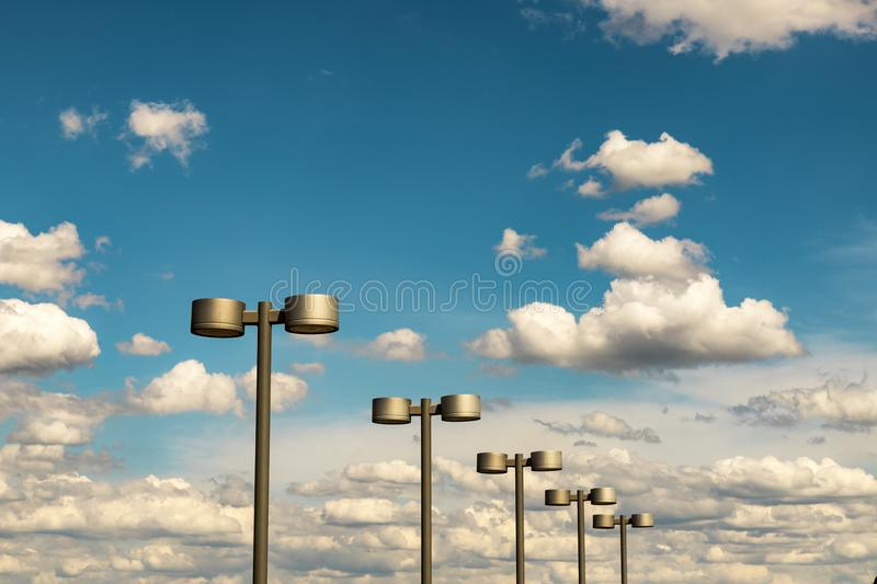 Street lanterns of steel color against the blue sky and beautiful clouds, Dnipro city, Ukraine royalty free stock photography