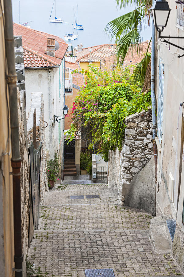 Street leading to sea in Villefranche-sur-Mer stock photos