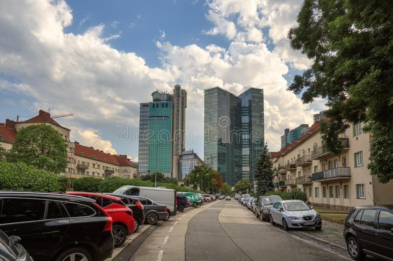 Street leading to the skyscrapers of the Winerberg City. District Favoriten, city of Vienna, Austria. VIENNA, AUSTRIA - JULY 10, 2017. Street leading to the stock image