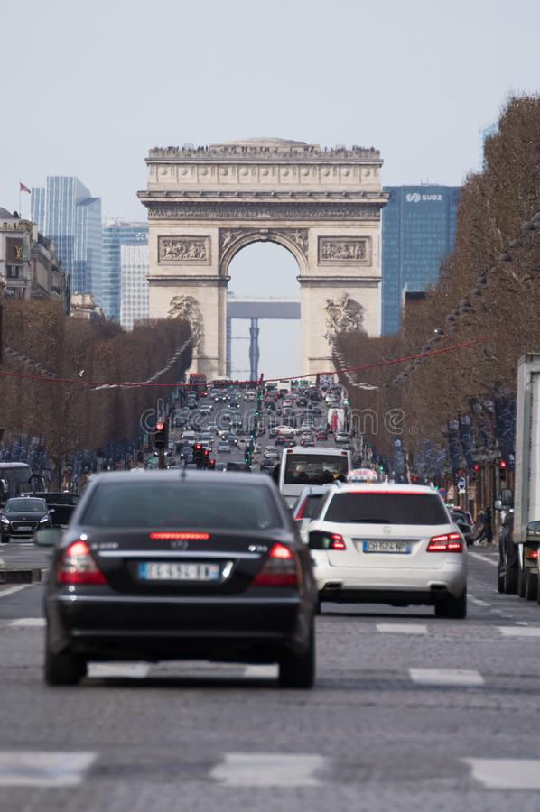 Street leading up to arc de triomphe on abusy day in Paris royalty free stock photography