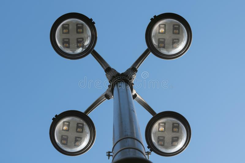 Street LED Lighting Technology. Light Pole Closeup. Sky, lamp, bright, illumination, blue, city, equipment, object, background, electric, electricity, energy stock photography