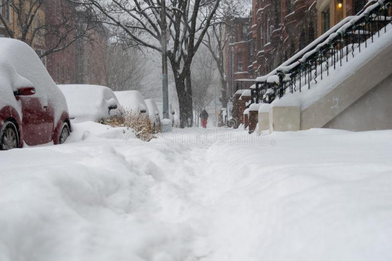 Street level shot during a blizzard with heavy snowfall in Harlem, New York City stock photos