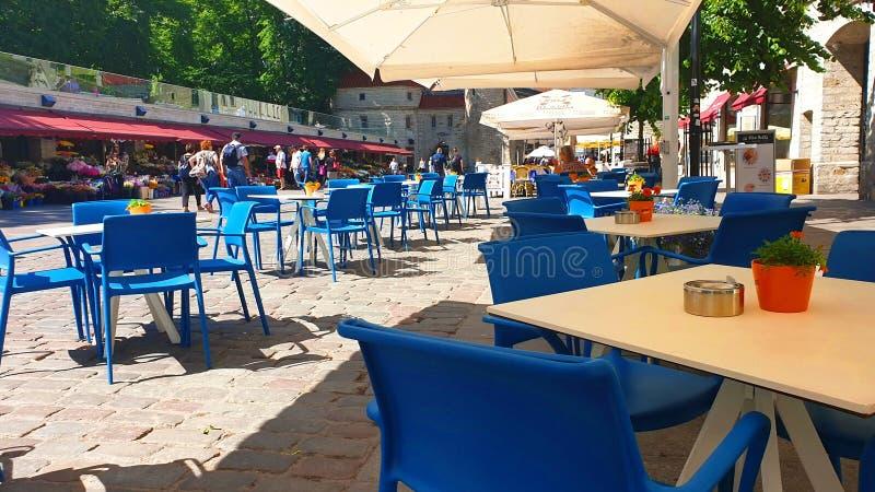 Street Cafe Lifestyle Tourist In the Old Town of Tallinn 2019,17.06 Summer in Estonia Europe Rickshaw bike royalty free stock image