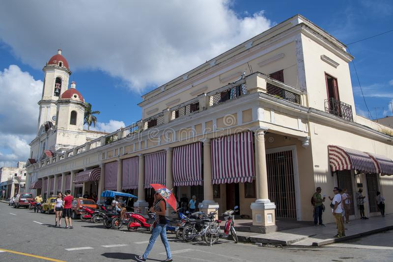 Street life with Cathedral in back, Cienfuegos, Cuba stock photo