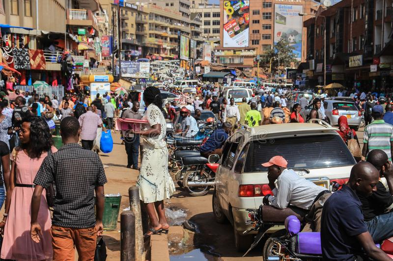 The street life of Uganda`s capital. Crowd of people on the streets and heavy traffic. Kampala, Uganda - January 28, 2018: The street life of Uganda`s capital stock photo