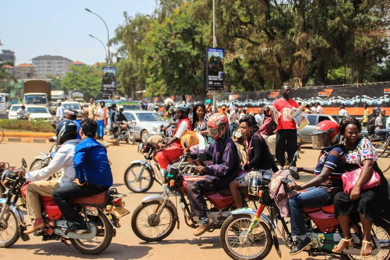 The street life of Uganda`s capital. Crowd of people on the streets and heavy traffic. Kampala, Uganda - January 28, 2018: The street life of Uganda`s capital stock photography