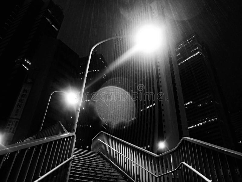 Street lighs over stairway at night stock images