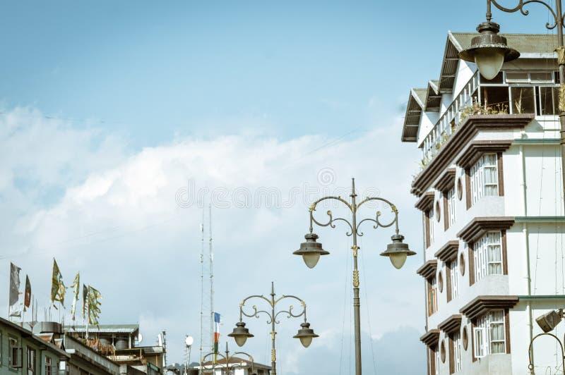 Street light against city buildings and blue sky background. Mini sensor solar lamp street light with blue clear sky stock image