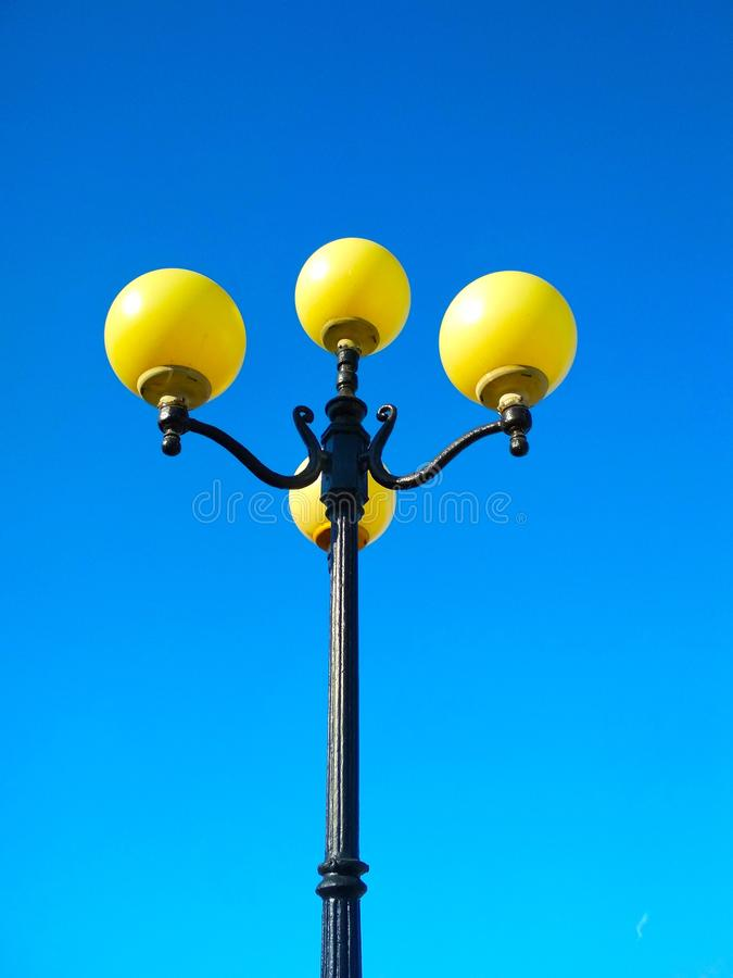 Street light, architectural decision. View of a street light against the background of the blue cloudless sky royalty free stock photos
