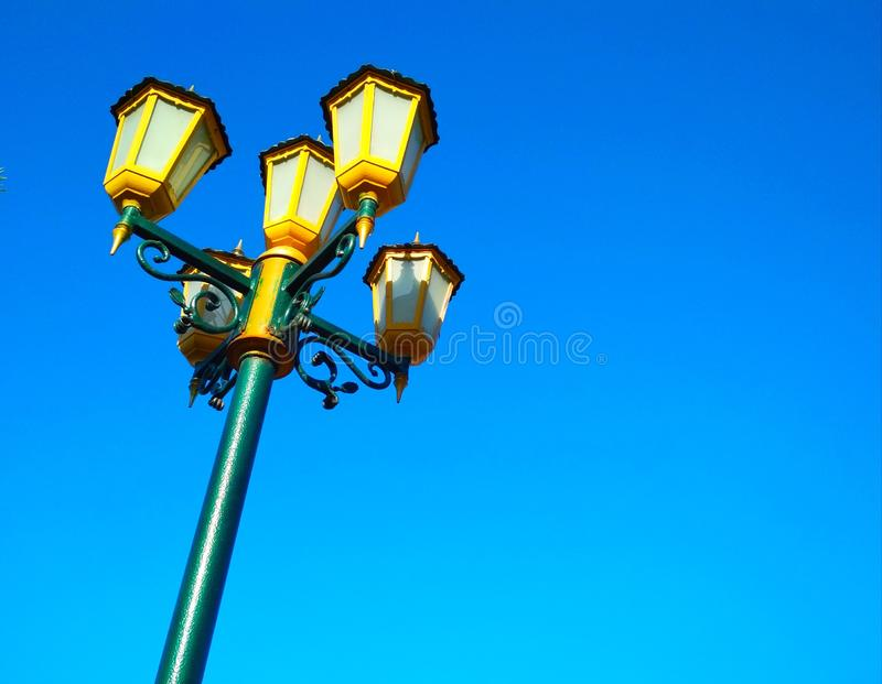 Street light, architectural decision. View of a street light against the background of the blue cloudless sky royalty free stock photography