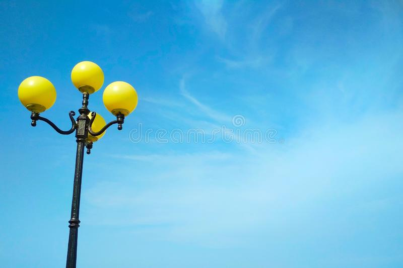 Street light, architectural decision. View of a street light against the background of the blue cloudy sky stock photos