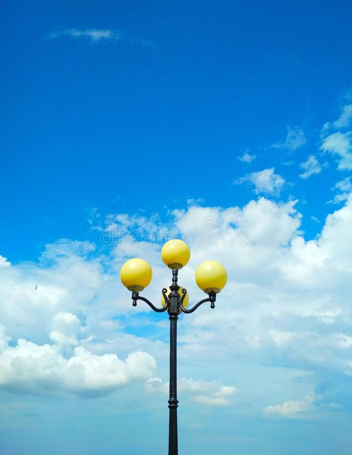 Street light, architectural decision. View of a street light against the background of the blue cloudy sky stock photo
