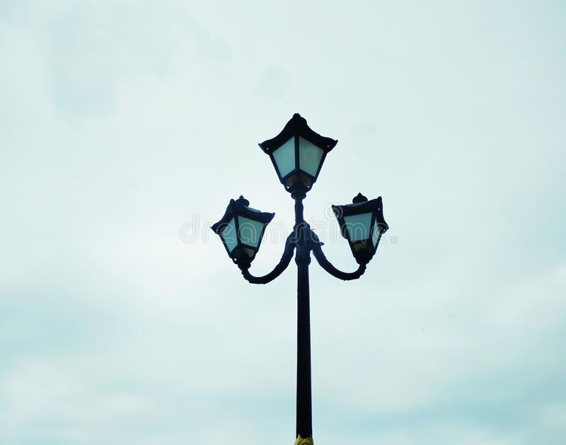 Street light, architectural decision. View of a street light against the background of the blue cloudy sky stock photography