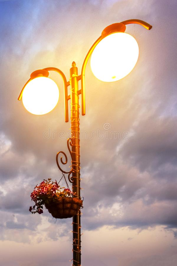 Street light on the background of a dramatic dark sky. Night city royalty free stock image