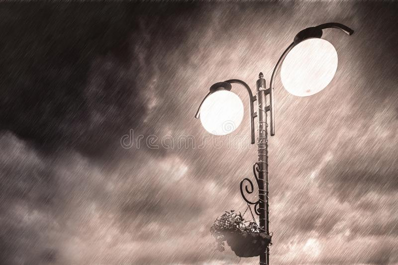Street light on the background of a dramatic dark sky. Night city. black-white royalty free stock image
