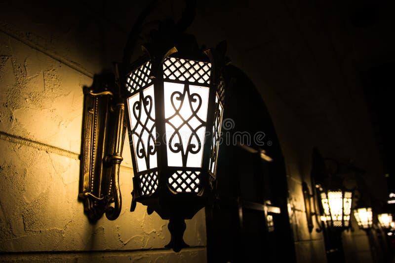Light bulb on wall stock photography