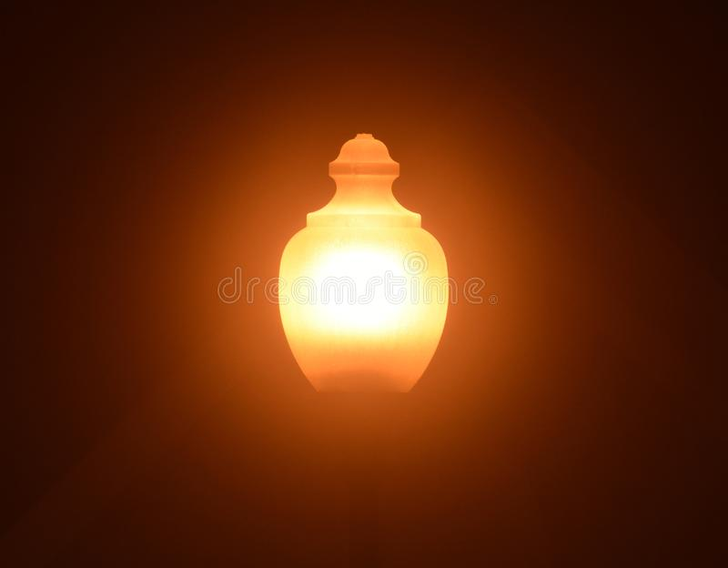 Street light on a very foggy night. A street light on a very foggy night diffuses the output from this low pressure sodium bulb royalty free stock image