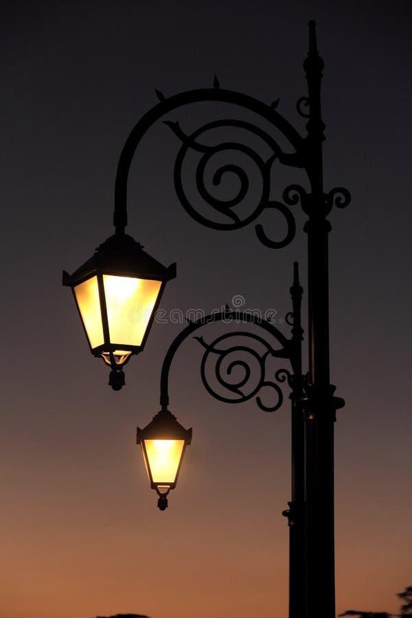 Street Light. Street lamp in working mode in the winter season royalty free stock photo