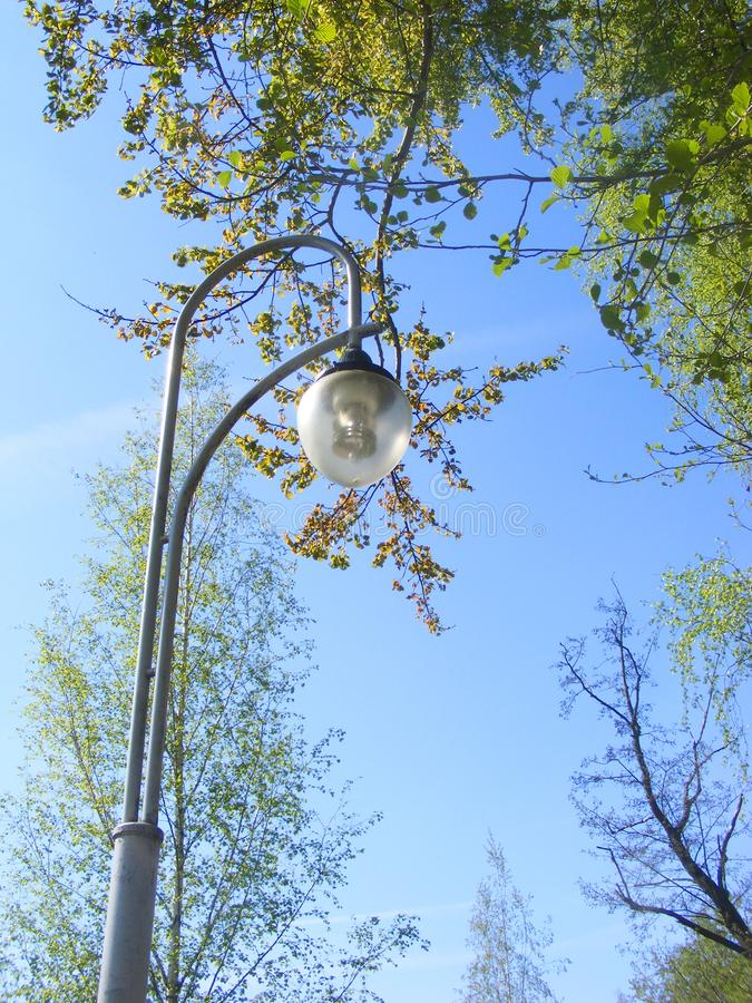 Street light mounted on a concrete pole with blue sky. Street light mounted on a concrete pole royalty free stock image