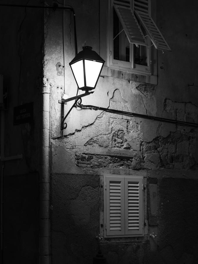Street light on an old house in Cres after sunset stock photo