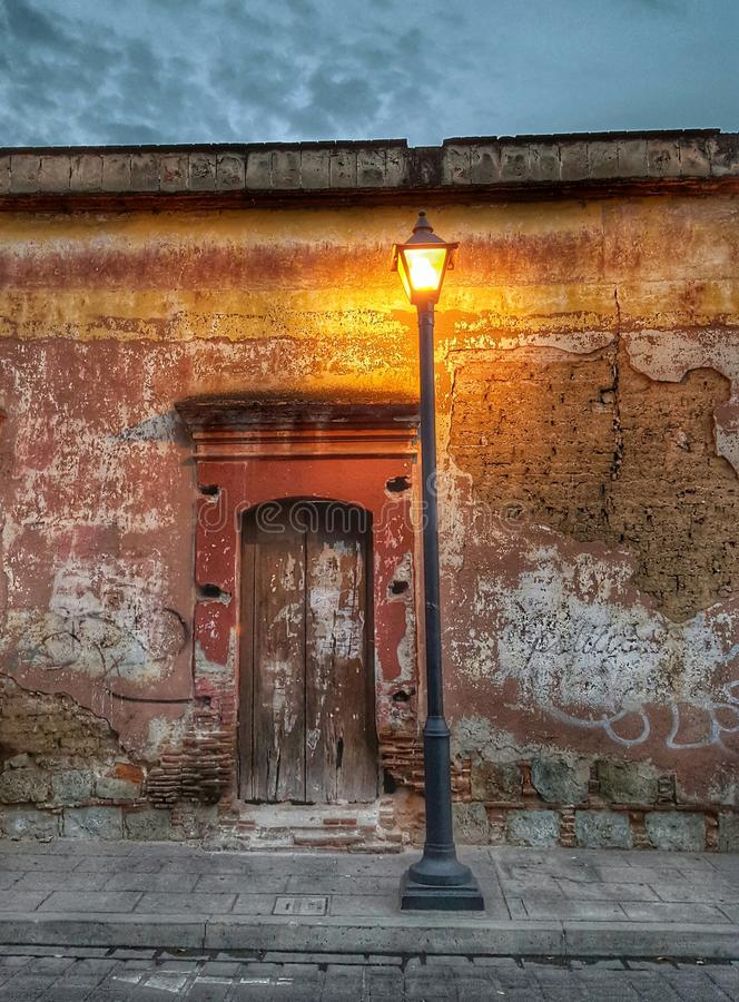 Street light. With an old wall in the streets of Oaxaca, Mexico stock photography