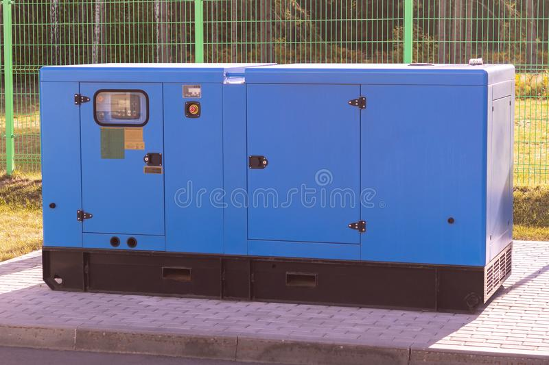 Street lighting. industrial generator that generates current. reserve. there is tinting. House, internet, technology, standby, power, alternate, diesel stock image