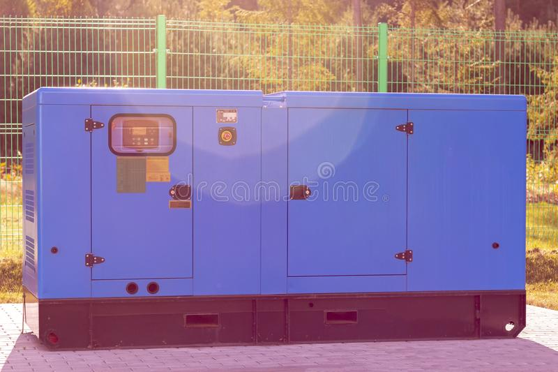 Street lighting. industrial generator that generates current. reserve. there is tinting. House, internet, technology, standby, power, alternate, diesel royalty free stock image