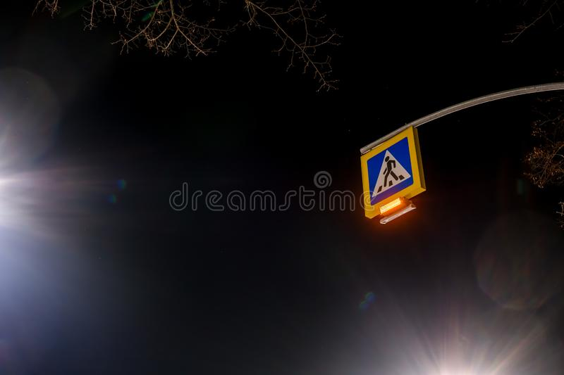 Street lighting, supports for ceilings with led lamps. concept of modernization and maintenance of lamps, place for text, night,. Road sign. crosswalk. a solar royalty free stock image