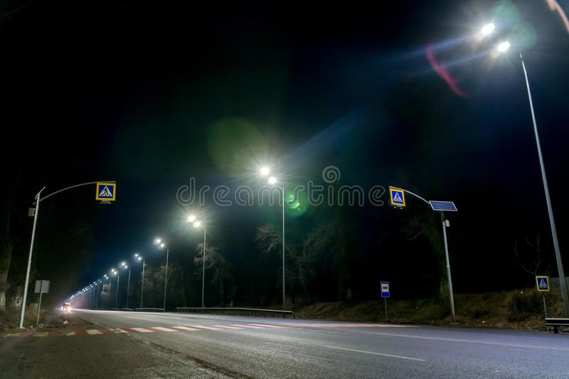 Street lighting, supports for ceilings with led lamps. concept of modernization and maintenance of lamps, place for text, night. Winter season. energy-saving royalty free stock photography