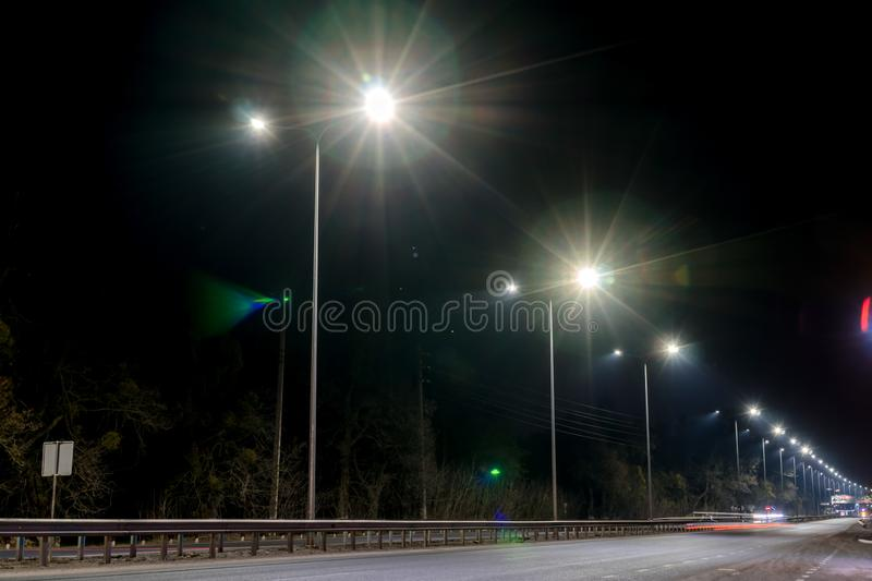 Street lighting, supports for ceilings with led lamps. concept of modernization and maintenance of lamps, place for text, night. Winter season. energy-saving stock images
