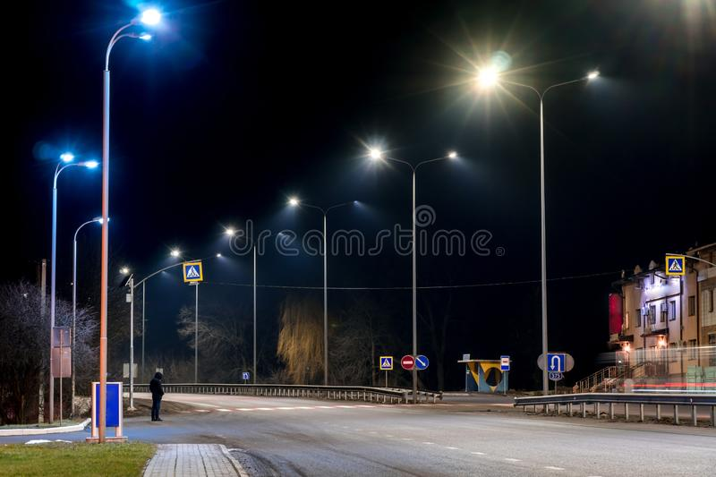 Street lighting, supports for ceilings with led lamps. concept of modernization and maintenance of lamps, place for text, night. Winter season. energy-saving stock photo