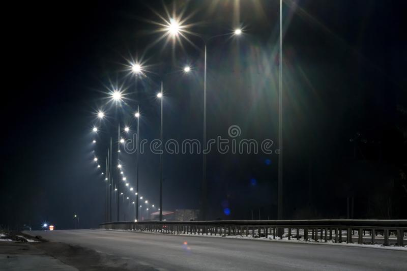 Street lighting, supports for ceilings with led lamps. concept of modernization and maintenance of lamps, place for text, night. Winter season. energy-saving royalty free stock image