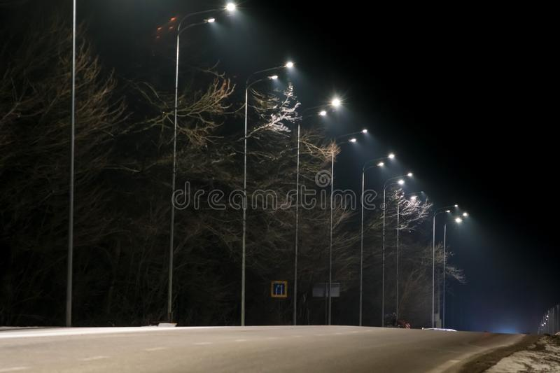 Street lighting, supports for ceilings with led lamps. concept of modernization and maintenance of lamps, place for text, night. Winter season. energy-saving royalty free stock images