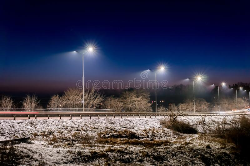 Street lighting, supports for ceilings with led lamps. concept of modernization and maintenance of lamps, place for text, night. Winter season. energy-saving stock photos