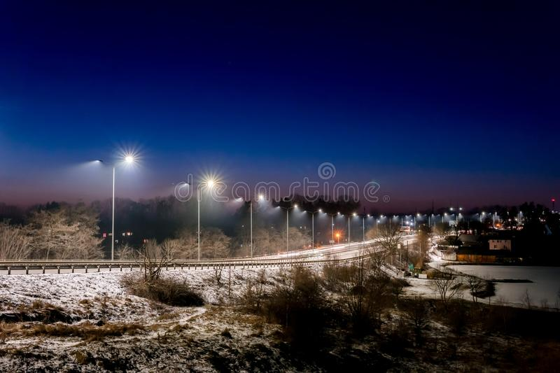 Street lighting, supports for ceilings with led lamps. concept of modernization and maintenance of lamps, place for text, night. Winter season. energy-saving royalty free stock photos