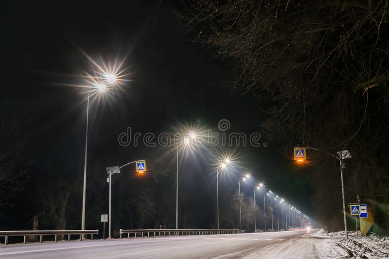 Street lighting, supports for ceilings with led lamps. concept of modernization and maintenance of lamps, place for text, night. Winter season. energy-saving stock photography