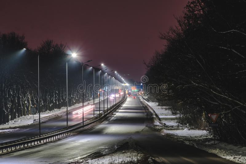 Street lighting, supports for ceilings with led lamps. concept of modernization and maintenance of lamps, place for text, night. Winter season. energy-saving royalty free stock photo