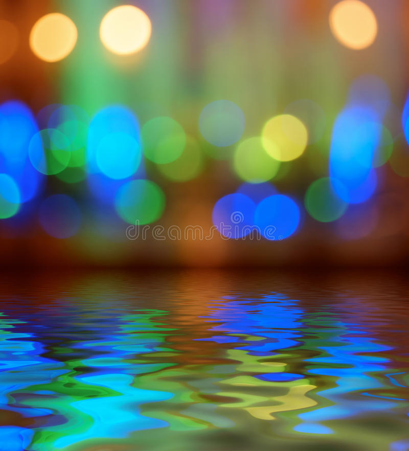 Street lights bokeh background reflection in water. Reflection in water street lights bokeh background royalty free stock images