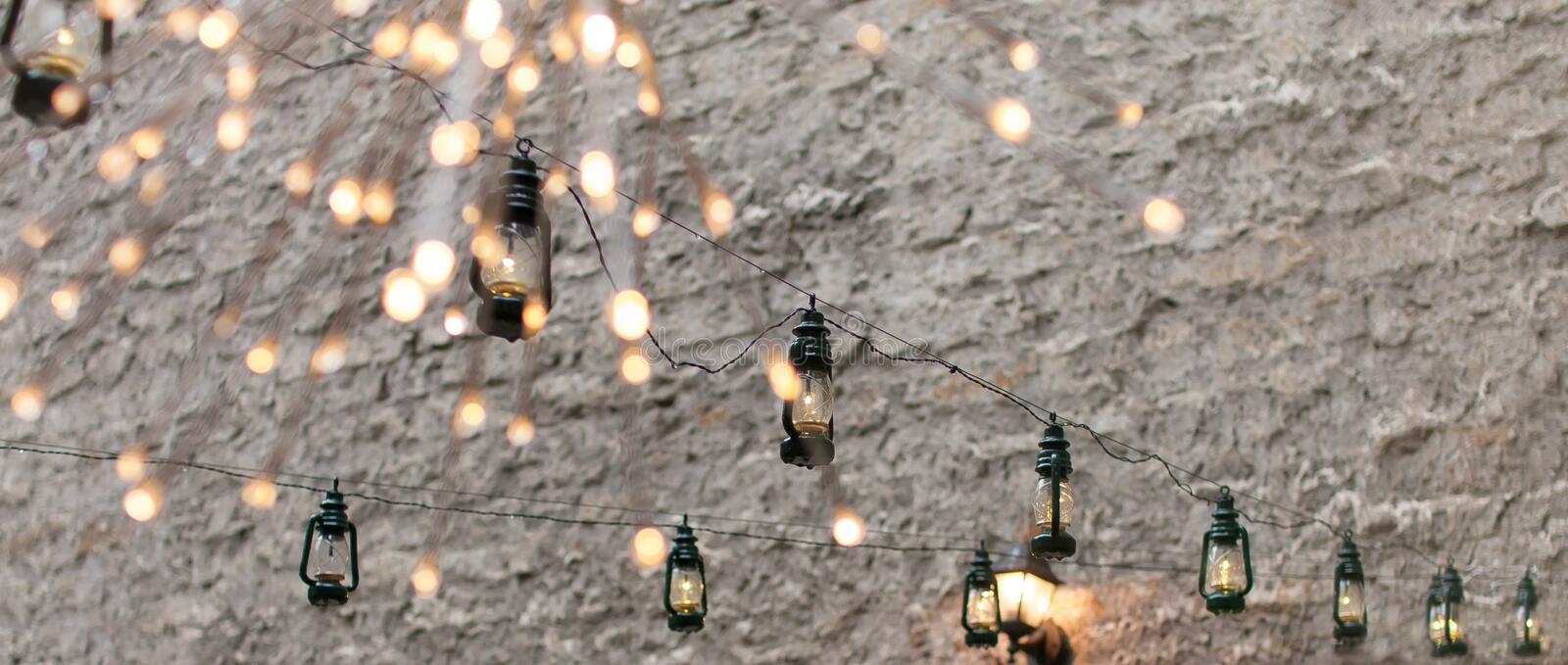 Street lights garlands lanterns decoration in the old town. Hanging outside royalty free stock photo