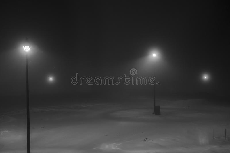 Street lights in the snow at night royalty free stock image