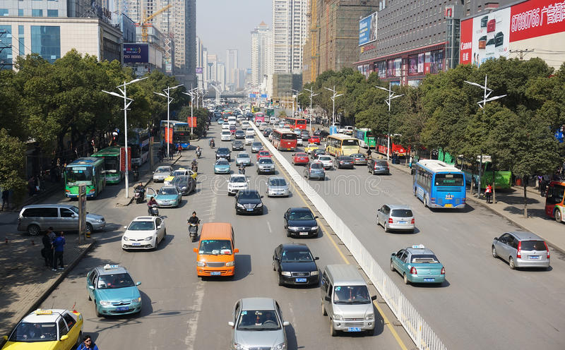 Street with cars in Wuhan of China. Street with lots of cars in Wuhan of China.Wuhan (simplified Chinese: 武汉) is the capital of Hubei province, People stock photos