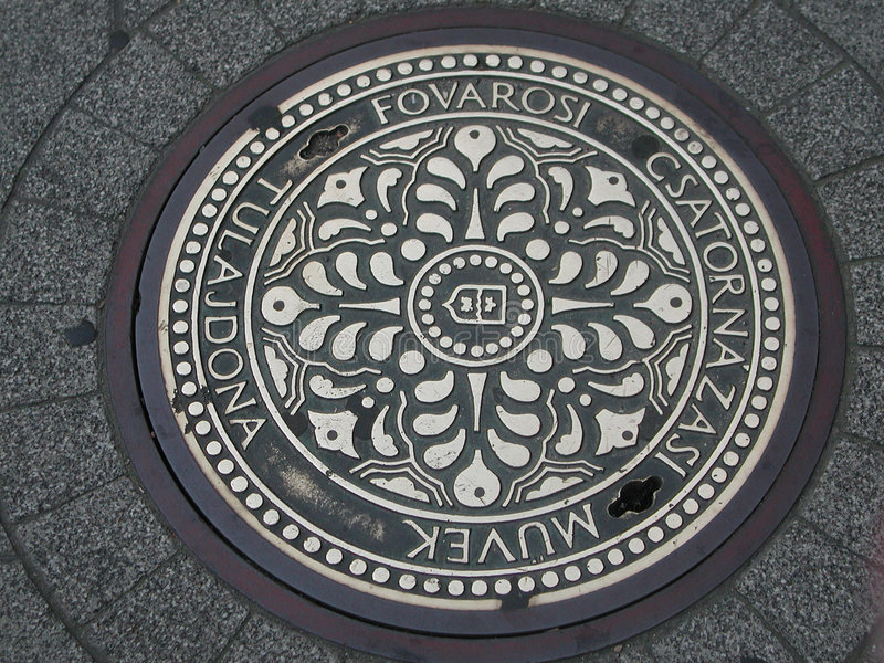 Street Manhole Cover royalty free stock photos
