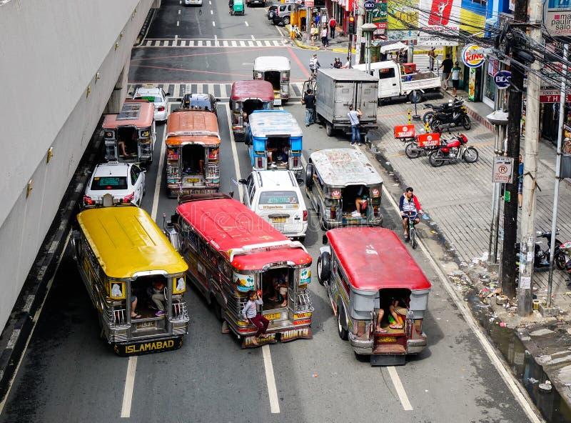 Street in Manila, Philippines. Manila, Philippines - Dec 20, 2015. Jeepneys running on street at downtown in Manila, Philippines. Manila is a major center for stock photos