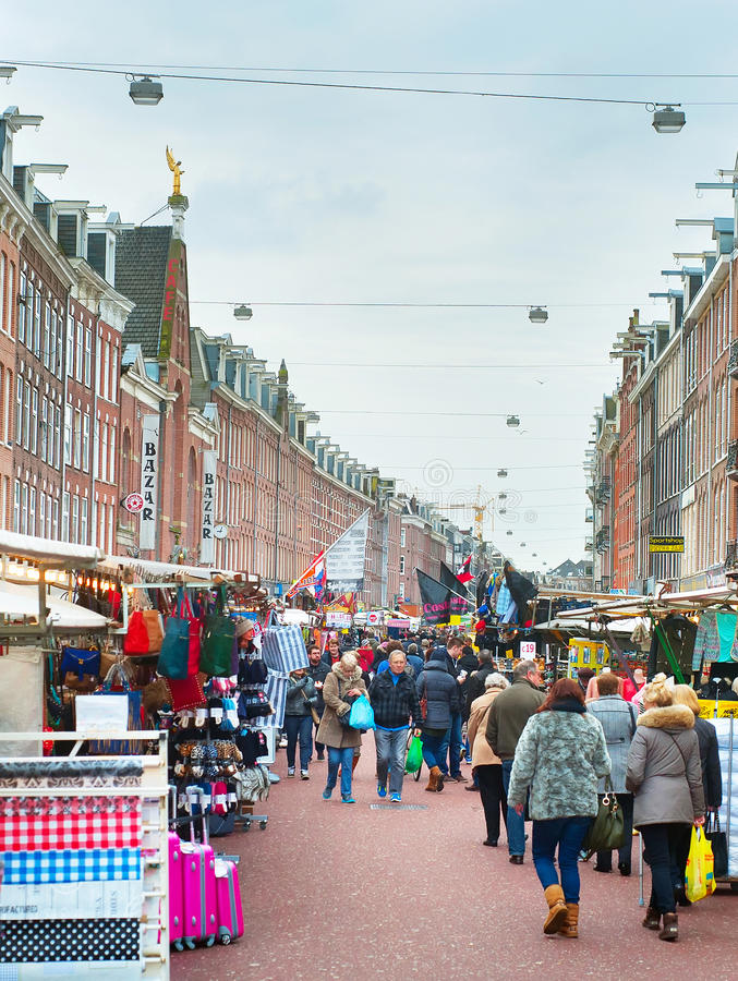 Street market Amsterdam. AMSTERDAM, NETHERLANDS - FEB 14, 2014: People at Albert Cuyp Market in Amsterdam. The market began trading in 1904, now over 300 stalls stock photography