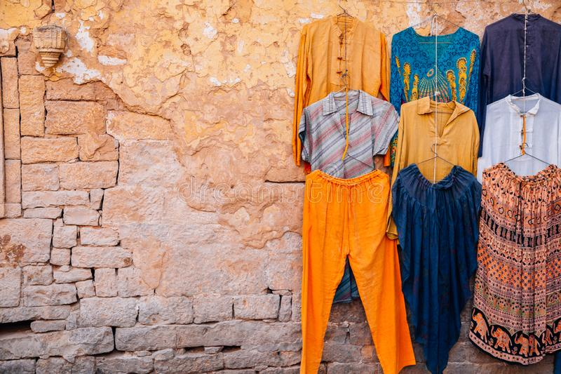 Street market Indian style clothes shop in India stock photography